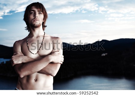 Shot of a sexual young man posing topless outdoors.