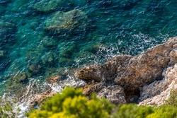 Shot of a shoreline rocks along the coast during the day