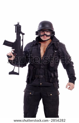 Shot of a soldier holding gun. Uniform conforms to special services(soldiers) of the NATO countries. Shot in studio. Isolated on white.