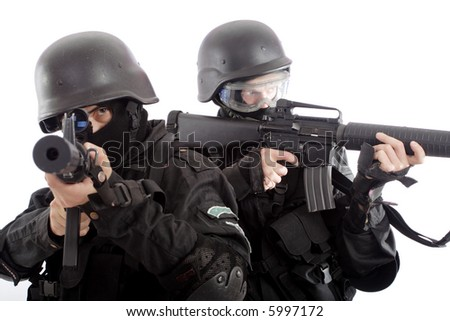 Shot of a soldier holding gun. Uniform conforms to special services(soldiers) of the NATO countries.