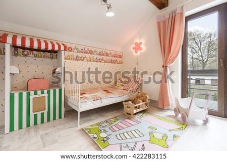 Shot of a spacious pink nursery room