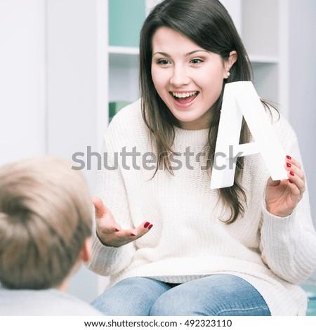 Shot of a speech therapist and a little boy