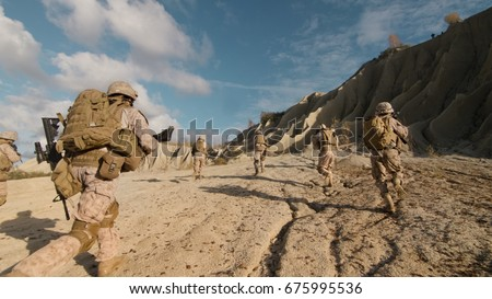 Shot of a Squad of Soldiers Running Forward and Atacking Enemy During Military Operation in the Desert.