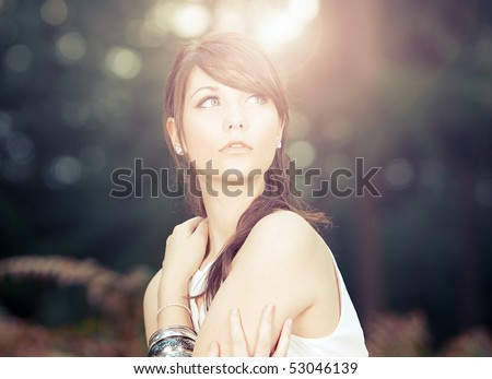 stock photo : Shot of a Stunning Teenage Model in Sunny Forest