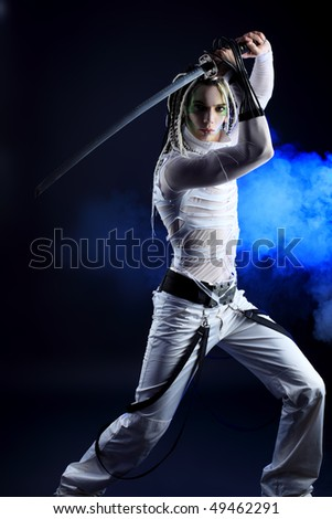 Shot of a stylish male warrior standing with his sword.