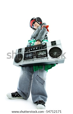 Shot of a trendy teenager listening to music in headphones. Isolated over white background.
