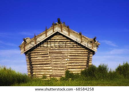 Shot of a typical finnish barn with a nice  texture on the building. - stock photo