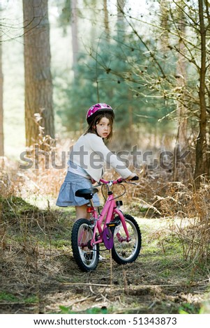 Shot of a Young Girl with her Bike in the Forest
