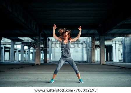 Shot of an athlete woman warming up for a workout. #708832195