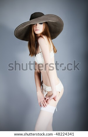 Shot of an attractive young woman in lingerie. - stock photo