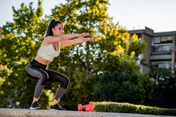 Shot of an attractive young woman working out outside