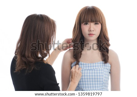 Shot of Asian working women preparing for modeling portrait shooting inside studio, young lady in blue checked dress stand and looking at camera, on isolated white background