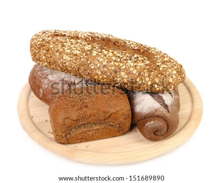 shot of assorted bread in a wooden tray