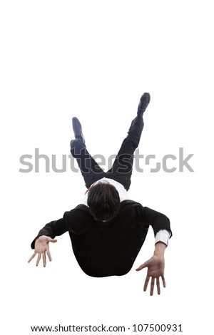 Shot of businessman falling down. shot in studio isolated on white
