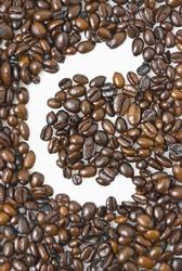Shot of coffee beans framing letter C