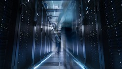 Shot of Corridor in Large Data Center Full of Moving and Working People. Pronounced Motion Blur.