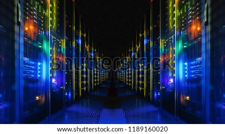 Shot of Corridor in Large Working Data Center Full of Rack Servers and Supercomputers.