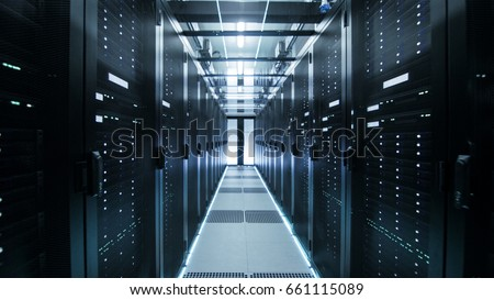 Shot of Corridor in Working Data Center Full of Rack Servers and Supercomputers.