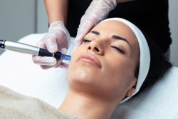Shot of cosmetologist making mesotherapy injection with dermapen on face for rejuvenation on the spa center.