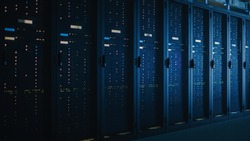 Shot of Dark Data Center With Multiple Rows of Fully Operational Server Racks. Modern Telecommunications, Cloud Computing, Artificial Intelligence, Database, Supercomputer.