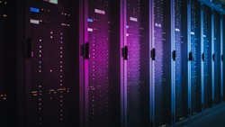 Shot of Dark Data Center With Multiple Rows of Fully Operational Server Racks. Modern Telecommunications, Cloud Computing, Artificial Intelligence, Database, Supercomputer. Pink Neon Light.