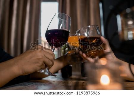 shot of friends enjoying drinks at bar together. #1193875966