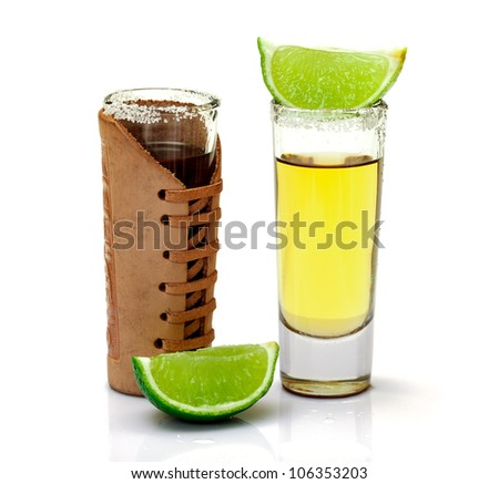 Shot of Gold Tequila with Slice Lime on white background - stock photo