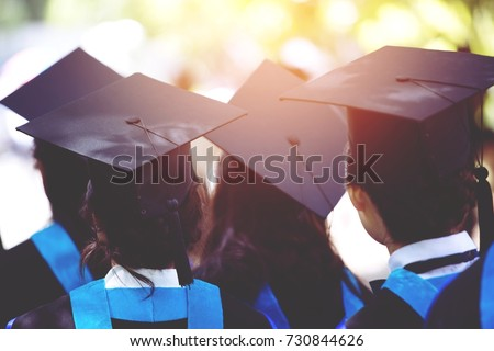 shot of graduation hats during...
