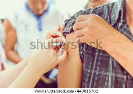 Shot of human hands making an injection with a syringe