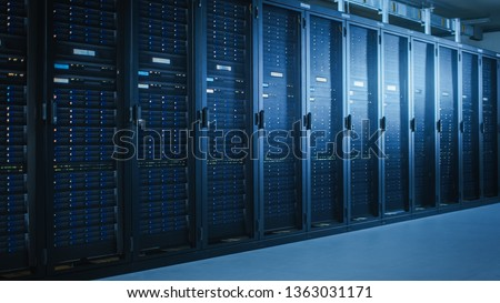 Shot of Modern Data Center With Multiple Rows of Fully Operational Server Racks. Modern High-Tech Telecommunications Database Super Computer in a Room. #1363031171