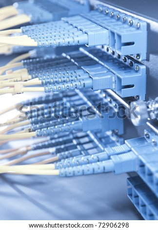 shot of network cables and servers in a technology data center