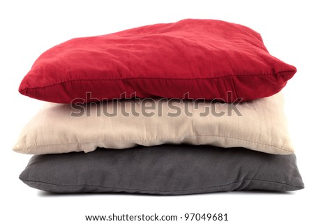 Shot of red, beige and gray/blue pillow on white background