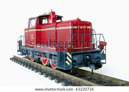Shot of red model railway over white background. - stock photo
