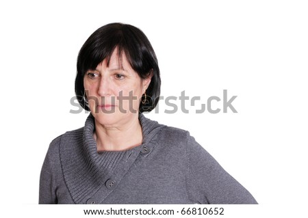 Shot of sad looking aged woman isolated on white background.