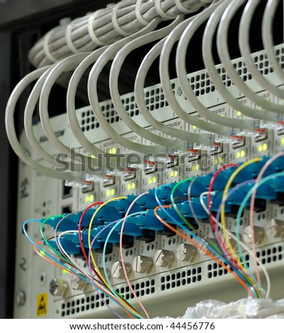 shot of servers and network cables  in a technology data center see more in my portfolio