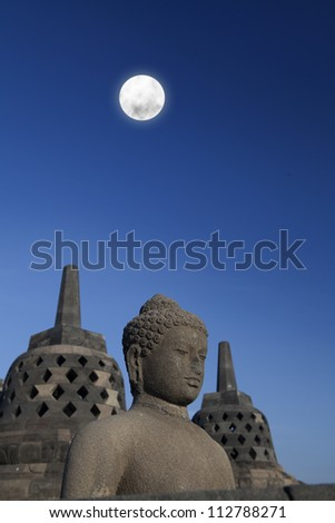 Shot of statue and stupa at borobudur temple Yogyakarta Java Indonesia