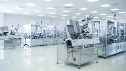 Shot of Sterile Precision Manufacturing Laboratory with 3D Printers, Super Computers and other Electrical Equipment and Machines suitable for Pharmaceutics, Biotechnology and Semiconductor Researches.