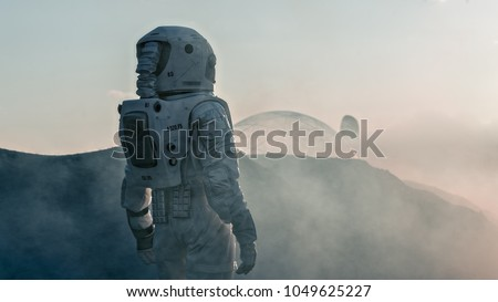 Shot of the Astronaut on Red Planet Watching Toward His Base/Research Station. Near Future First Manned Mission To Mars, Technological Advance Brings Space Exploration, Colonization.