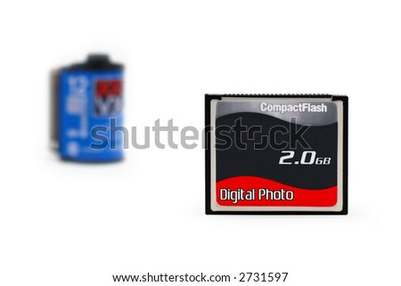 shot of the digital flash memory card (Shallow DOF) and old-style 35 mm film on a white background with pretty shadows