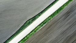 Shot of the field from drone. Farmers field. Road between fields