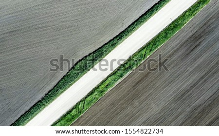Shot of the field from drone. Farmers field. Road between fields. Background or texture Stock foto ©