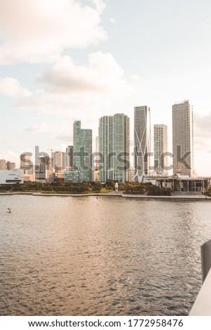 Shot of the Miami Skyline from bridge including One Thousand Museum.