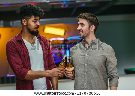 Shot of two man cheering with beer #1178788618