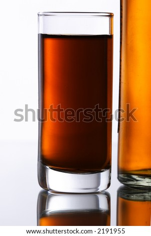 shot of whiskey with shaker and bottle beside