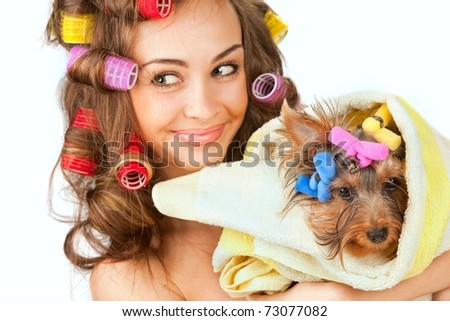 Shot of young adult female with Yorkshire Terrier dog - stock photo