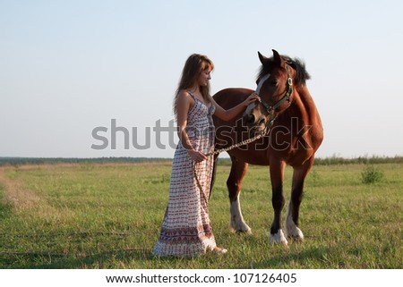 shot of young caucasian woman with her horse