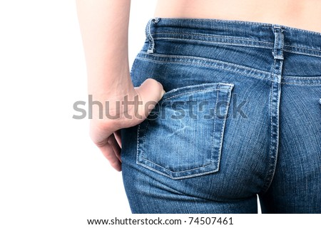 Shot of young woman behind in worn out jeans
