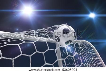 Shot on goal, soccer ball in the net