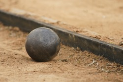 Shot put on athletic field.