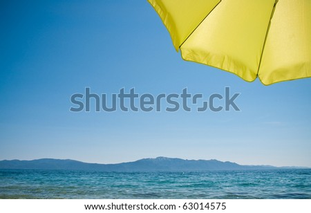 shot taken at the beach under a green sun umbrella